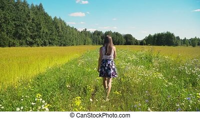 Girl walking on the field.