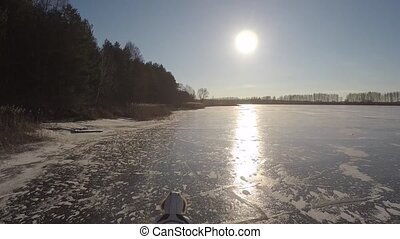 girl walking on the frozen ice