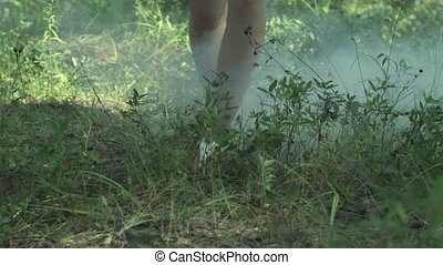 Girl walking on the green grass in wild nature.