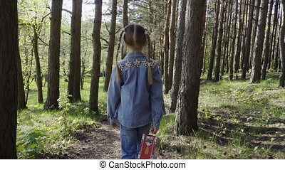 girl walking the forest with a picnic box - Little girl...
