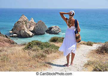 Girl walking to the beach at the Aphrodite birthplace,...