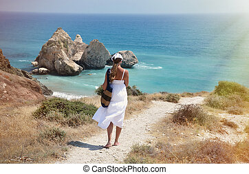 Girl walking to the beach near Aphrodite birthplace, Cyprus