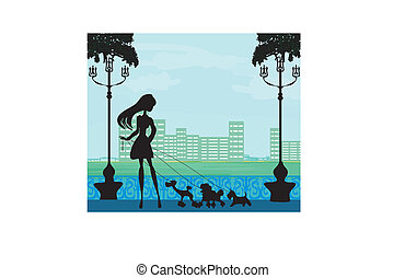 girl walking with her dogs