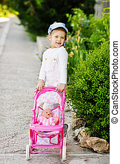 girl walking with  stroller