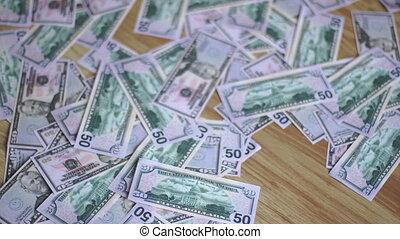 girl walks barefoot on money close up