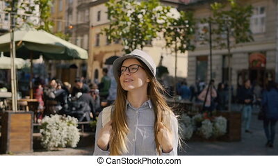 Girl Walks Happily in City Center - Intelligent caucasian...