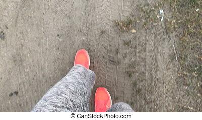 girl walks in pink sneakers on Earth top view