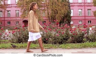 girl walks in town