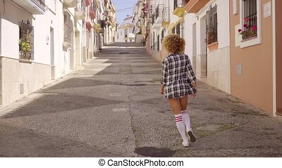 Girl Walks The Mediterranean Street Along - Young exotic...