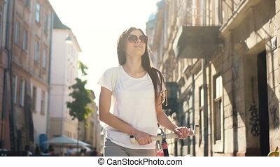 Girl Walks with Bike - Tall pretty woman walking through the...