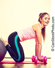 Girl warming up with ball and dumb bell weights. - Exercise...