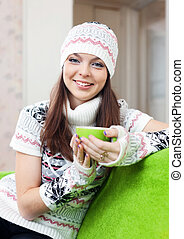 girl warms with cup of tea