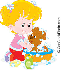 Girl washing a puppy - Little girl washes her small pup in a...