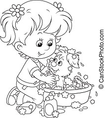Girl washing her puppy - Little girl washes a small pup in a...