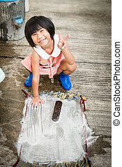 Girl washing outdoor.