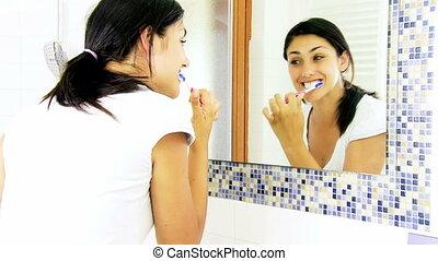 Girl washing teeth in bathroom