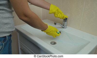 girl washing wash basin washbasin - girl washes washbasin in...