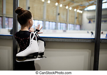 Girl Watching Figure Skaters