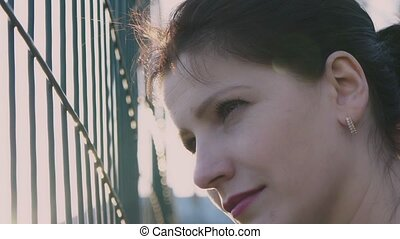 Girl watching from behind a fence, slow motion, 120fps, The...