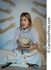 Girl Watching Horror Movie - Beautiful young woman watching...
