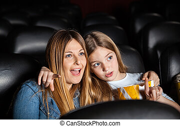 Girl Watching Movie With Shocked Mother In Theater
