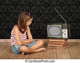 girl watching old tv