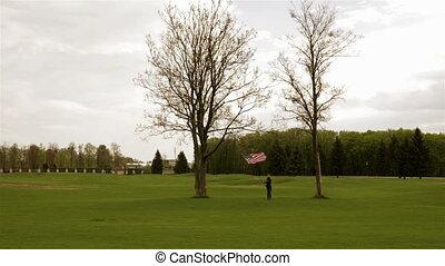 Girl waving flag of USA