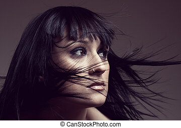 Girl waving hair - Fashion portrait of a woman with waving...