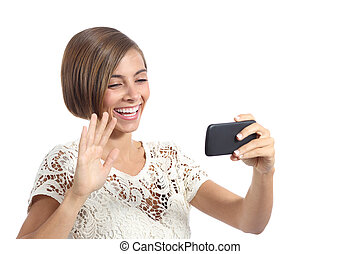Girl waving on the smart phone while during a video call