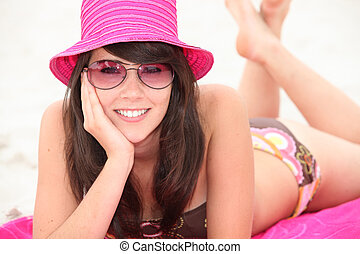 Girl wearing a sun hat