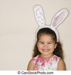 Girl wearing bunny ears.
