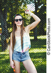 Girl wearing cap and sunglasses