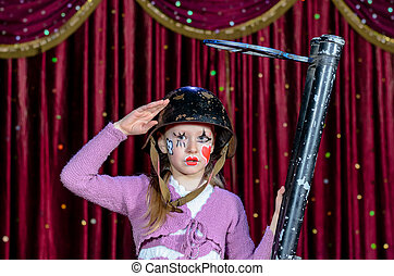 Girl Wearing Clown Make Up Holding Large Gun