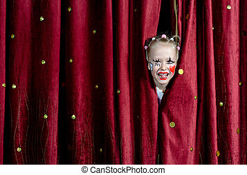 Girl Wearing Clown Makeup Peeking Through Curtains
