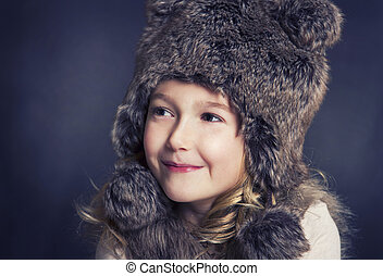 Girl wearing fur hat