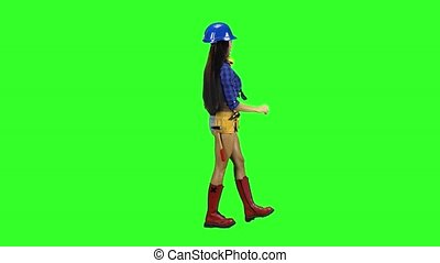 Girl wearing helmet and boots goes sideways on a green background