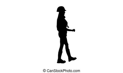 Girl wearing helmet and boots goes . Silhouette. White background . Side view