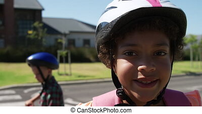 Girl wearing helmet smiling on the road - Portrait close up ...