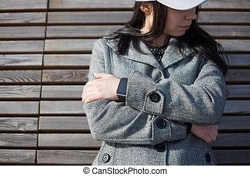 Girl wearing modern smart watch on her wrist
