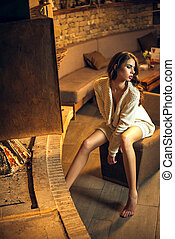 Girl wearing pullover near fireplace - Young attractive...