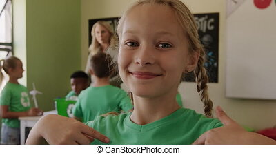Girl wearing recycle symbol tshirt smiling - Portrait of ...