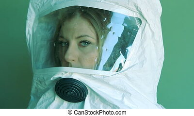 Girl wearing safety suit. Side view