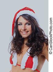 girl wearing santa claus clothes