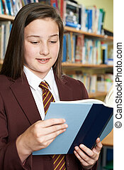 Girl Wearing School Uniform Reading Book In Library