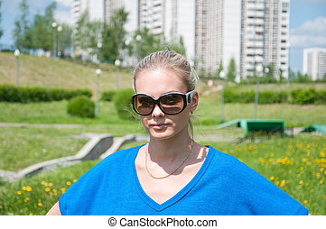 Girl wearing sunglasses in a city park