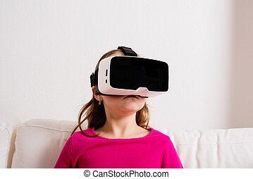 Girl wearing virtual reality goggles. Studio shot, copy...