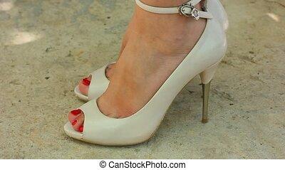 Girl wears shoes on high heels