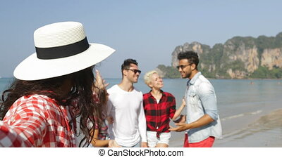 Girl Welcome People Group To Take Selfie Photo On Beach On...
