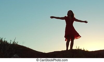girl whirling silhouette sunset concept freedom. slow motion...