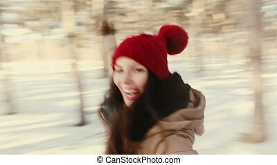 Girl whirls, laughing at the camera. Winter, Snow, Forest...